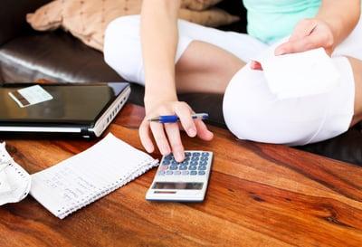 Beautiful woman doing accountancy at home.jpeg